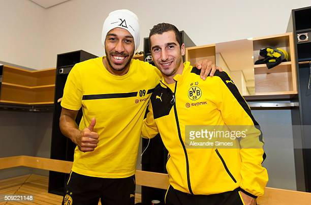 PierreEmerick Aubameyang and Henrikh Mkhitaryan of Borussia Dortmund celebrate the win together in the changing room after the DFB Cup match between...