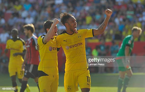 PierreEmerick Aubameyang and Jonas Hofmann of Borussia Dortmund celebrate their team's fourth goal during the Bundesliga match between FC Ingolstadt...