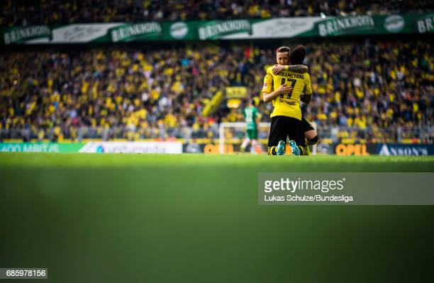 PierreEmerick Aubameyang and Marco Reus of Dortmund celebrate their teams fourth goal during the Bundesliga match between Borussia Dortmund and...