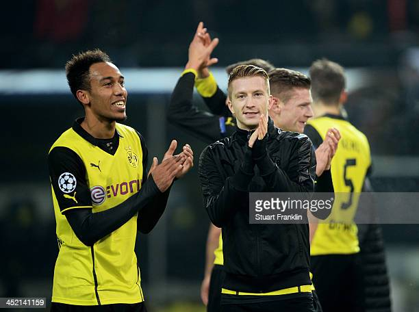 PierreEmerick Aubameyang and Marco Reus of Dortmund celebrate victory after the UEFA Champions League Group F match between Borussia Dortmund and SSC...