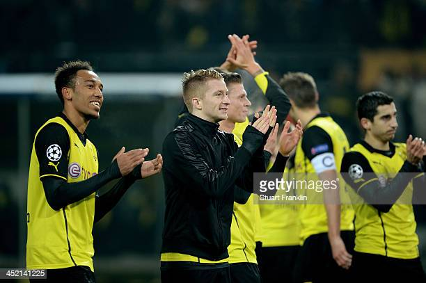 PierreEmerick Aubameyang and Marco Reus of Dortmund celebrate victory with team mates after the UEFA Champions League Group F match between Borussia...
