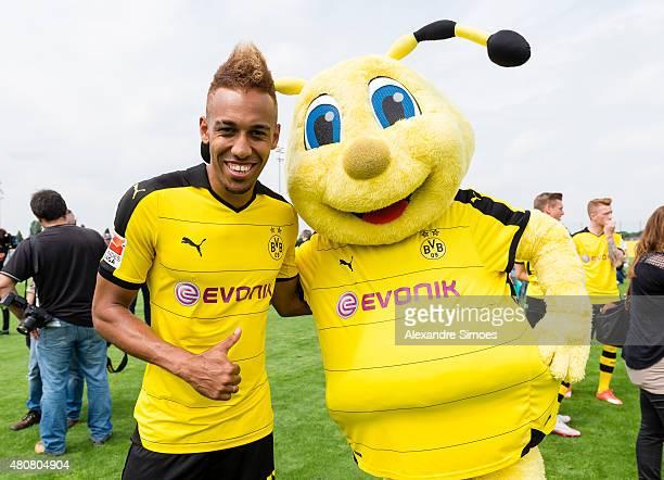 PierreEmerick Aubameyang and mascot Emma of Borussia Dortmund poses during the Bundesliga media day 2015 at Borussia Dortmund's training ground at...