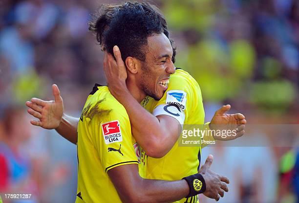 PierreEmerick Aubameyang and Mats Hummels of Dortmund celebrate their second goal during the Bundesliga match between FC Augsburg and Borussia...