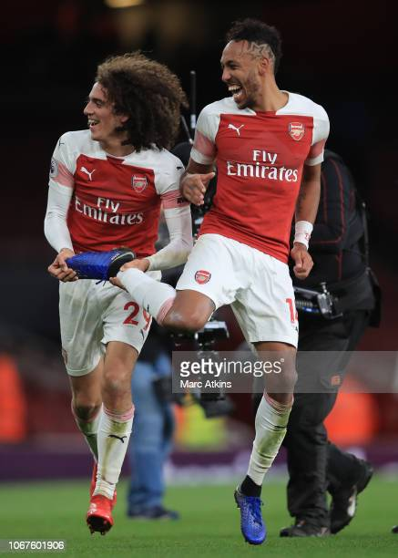 Pierre-Emerick Aubameyang and Matteo Guendouzi of Arsenal celebrate the win during the Premier League match between Arsenal FC and Tottenham Hotspur...
