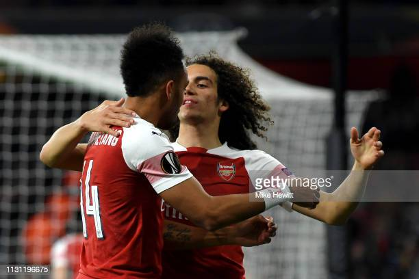 PierreEmerick Aubameyang and Matteo Guendouzi of Arsenal celebrate their team's first goal an own goal scored by Zakhar Volkov of FC BATE during the...
