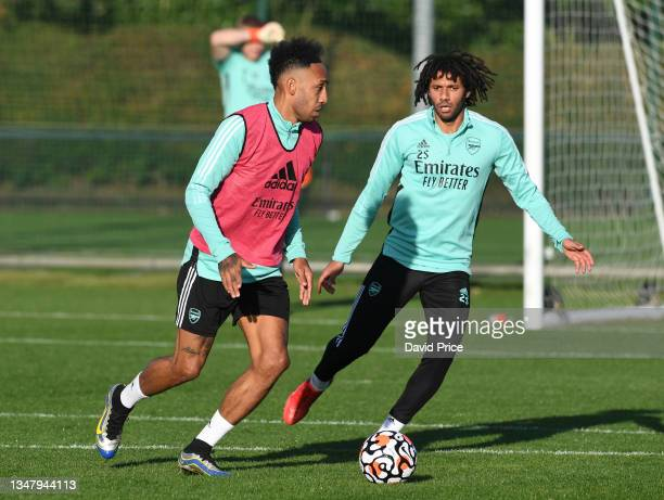 Pierre-Emerick Aubameyang and Mohamed Elneny of Arsenal during the Arsenal 1st team training session at London Colney on October 21, 2021 in St...