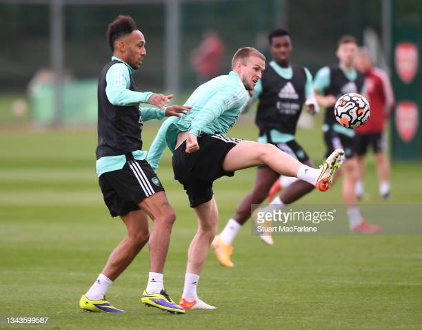 Pierre-Emerick Aubameyang and Rob Holding of Arsenal during a training session at London Colney on September 28, 2021 in St Albans, England.