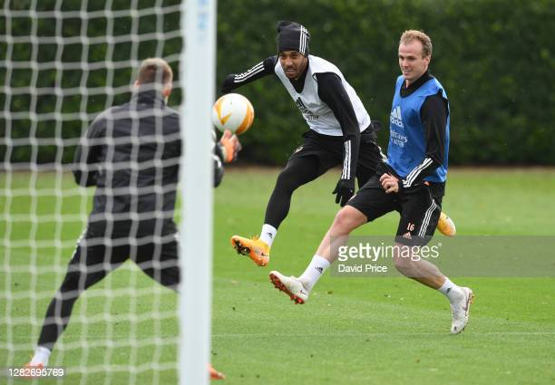PierreEmerick Aubameyang and Rob Holding of Arsenal during the Arsenal training session ahead of the UEFA Europa League Group B stage match between...