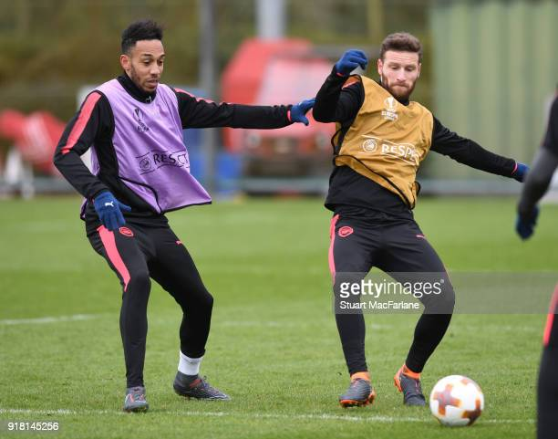PierreEmerick Aubameyang and Shkodran Mustafi of Arsenal during a training session at London Colney on February 14 2018 in St Albans United Kingdom