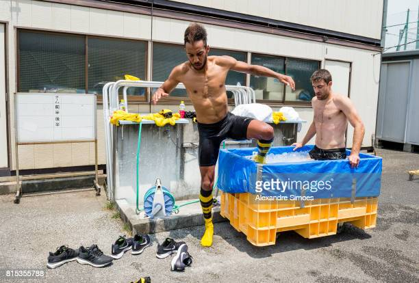 PierreEmerick Aubameyang and Sokratis Papastathopoulos of Borussia Dortmund are cooling down in the ice bath after a training session on July 16 2017...