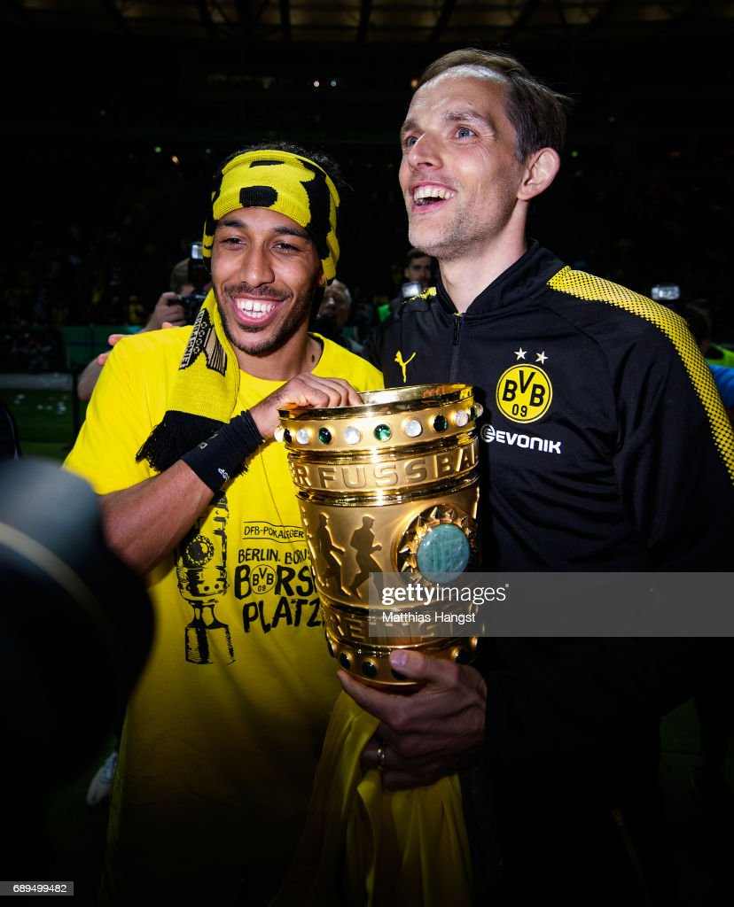 Pierre-Emerick Aubameyang and Thomas Tuchel of Dortmund celebrate with the trophy after winning the DFB Cup Final 2017 between Eintracht Frankfurt and Borussia Dortmund at Olympiastadion on May 27, 2017 in Berlin, Germany.