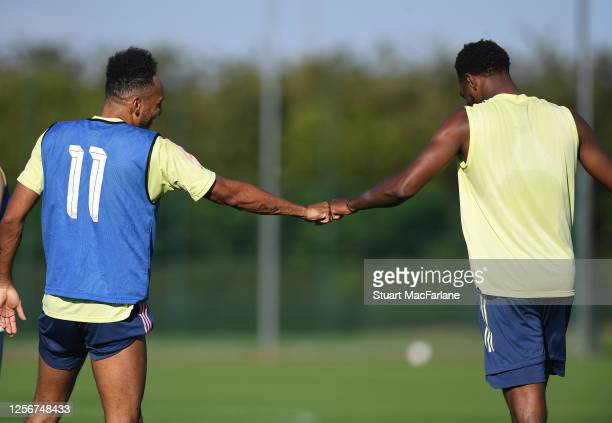 Pierre-Emerick Aubameyang and Zech Medley of Arsenal during a training session at London Colney on July 17, 2020 in St Albans, England.