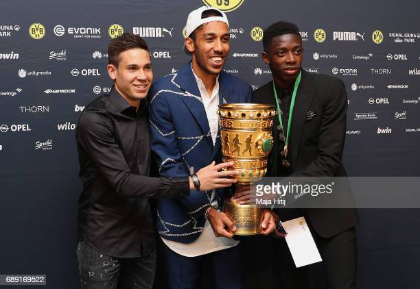 PierreEmerick Aubameyang arrives with the trophy for the Borussia Dortmund champions party at the Grand Hyatt Hotel following their DFB Cup Final...