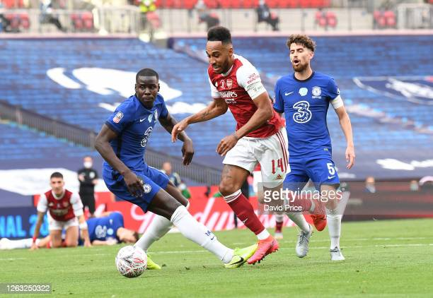 PierreEmerick Aubameyang beats Kurt Zouma of Chelsea to score his and Arsenal's 2nd goal during the FA Cup Final match between Arsenal and Chelsea at...