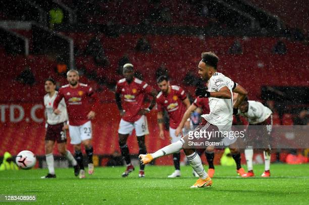 Pierre-Emerick Aubameyang celebrates after scores from the penalty spot during the Premier League match between Manchester United and Arsenal at Old...