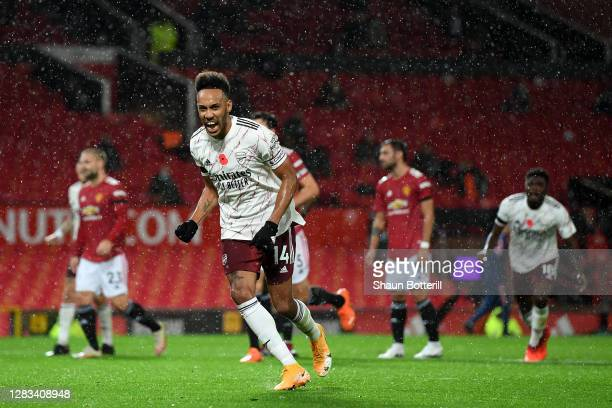 Pierre-Emerick Aubameyang celebrates after scoring from the penalty spot during the Premier League match between Manchester United and Arsenal at Old...