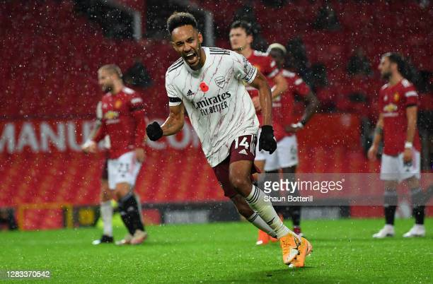 Pierre-Emerick Aubameyang celebrates after scoring his sides first goal during the Premier League match between Manchester United and Arsenal at Old...