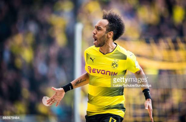 PierreEmerick Aubameyang celebrates his teams fourth goal during the Bundesliga match between Borussia Dortmund and Werder Bremen at Signal Iduna...