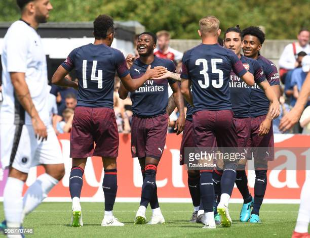 PierreEmerick Aubameyang celebrates scoing a goal for Arsenal with Ainsley MaitlandNiles during the match between Borehamwood and Arsenal at Meadow...