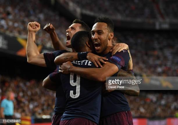 Pierre-Emerick Aubameyang celebrates scoring a goal for Arsenal with Alexandre Lacazette and Granit Xhaka during the UEFA Europa League Semi Final...