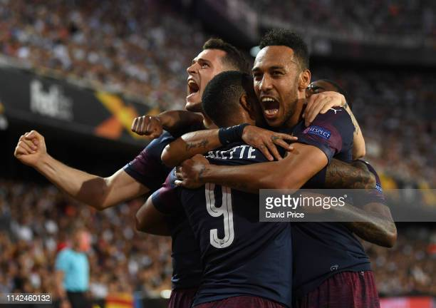 PierreEmerick Aubameyang celebrates scoring a goal for Arsenal with Alexandre Lacazette and Granit Xhaka during the UEFA Europa League Semi Final...