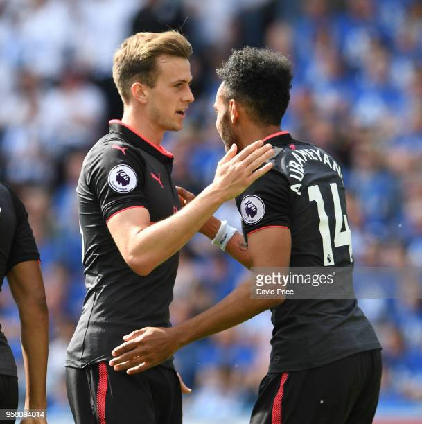 PierreEmerick Aubameyang celebrates scoring a goal for Arsenal with Rob Holding during the Premier League match between Huddersfield Town and Arsenal...