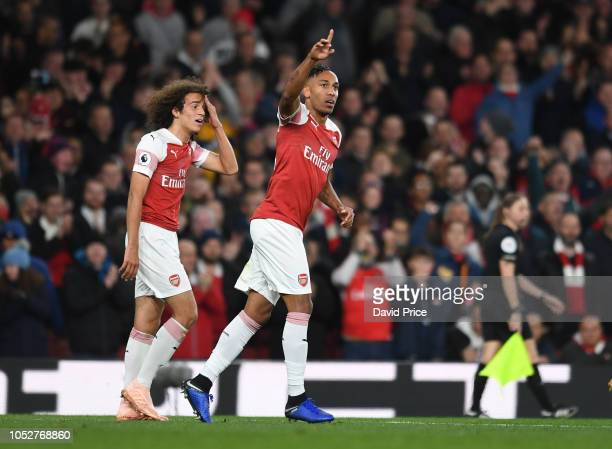 PierreEmerick Aubameyang celebrates scoring Arsenal's 3rd goal during the Premier League match between Arsenal FC and Leicester City at Emirates...