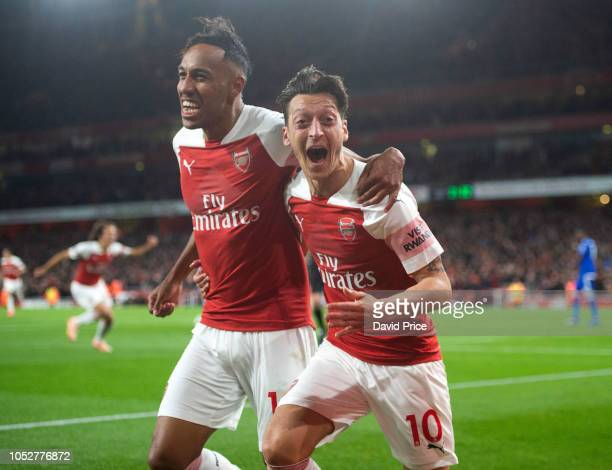 PierreEmerick Aubameyang celebrates scoring Arsenal's 3rd goal with Mesut Ozil during the Premier League match between Arsenal FC and Leicester City...
