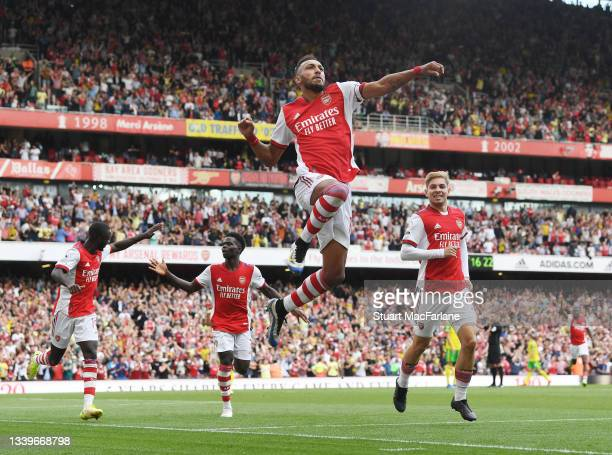 Pierre-Emerick Aubameyang celebrates scoring for Arsenal during the Premier League match between Arsenal and Norwich City at Emirates Stadium on...