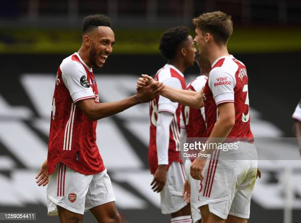 PierreEmerick Aubameyang celebrates scoring his 2nd goal Arsenal's 3rd with Kieran Tierney during the Premier League match between Arsenal FC and...
