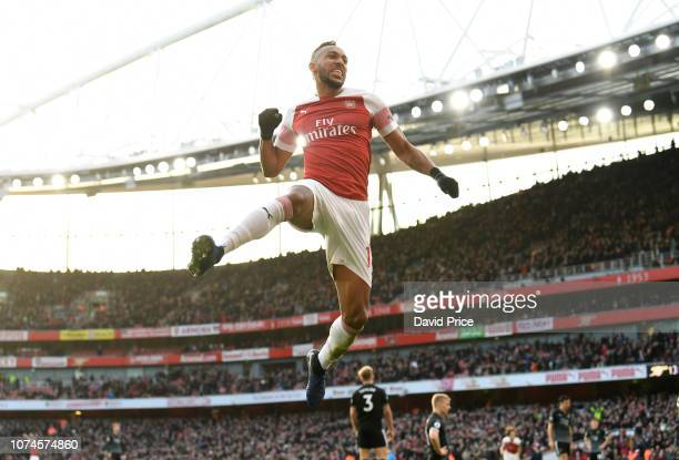 PierreEmerick Aubameyang celebrates scoring his and Arsenal's 2nd goal during the Premier League match between Arsenal FC and Burnley FC at Emirates...