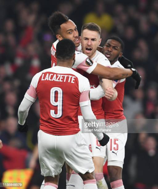 PierreEmerick Aubameyang celebrates scoring the 1st Arsenal goal with Alex Lacazette Aaron Ramsey and Ainlsey MailtandNiles during the UEFA Europa...