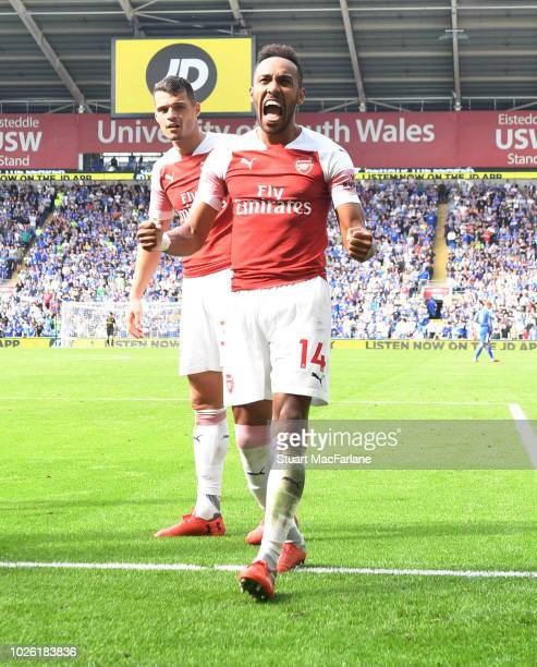 PierreEmerick Aubameyang celebrates scoring the 2nd Arsenal goal during the Premier League match between Cardiff City and Arsenal at Cardiff City...