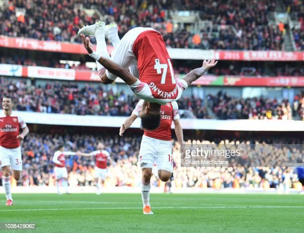 PierreEmerick Aubameyang celebrates scoring the 2nd Arsenal goal during the Premier League match between Arsenal FC and Everton FC at Emirates...