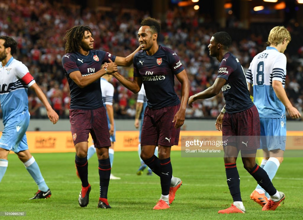Pierre-Emerick Aubameyang celebrates scoring the 2nd Arsenal goal with (L) Mo Elneny and (R) Ainsley Maitland-Niles during the Pre-season friendly between Arsenal and SS Lazio on August 4, 2018 in Stockholm, Sweden.