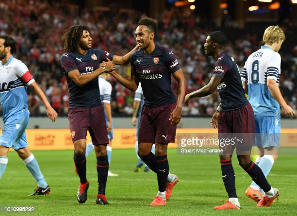 PierreEmerick Aubameyang celebrates scoring the 2nd Arsenal goal with Mo Elneny and Ainsley MaitlandNiles during the Preseason friendly between...