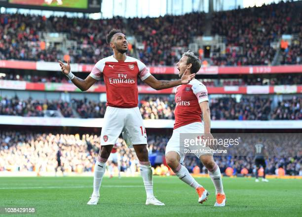 PierreEmerick Aubameyang celebrates scoring the 2nd Arsenal goal with R Nacho Monreal during the Premier League match between Arsenal FC and Everton...