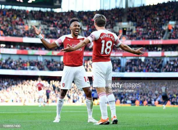 Pierre-Emerick Aubameyang celebrates scoring the 2nd Arsenal goal with Nacho Monreal during the Premier League match between Arsenal FC and Everton...