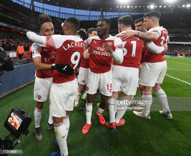 PierreEmerick Aubameyang celebrates scoring the 2nd Arsenal goal with Alex Lacazette and Ainsley MaitlandNiles during the Premier League match...