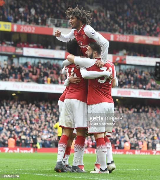 PierreEmerick Aubameyang celebrates scoring the 2nd Arsenal goal with Mohamed Elneny and Sead Kolasinac during the Premier League match between...