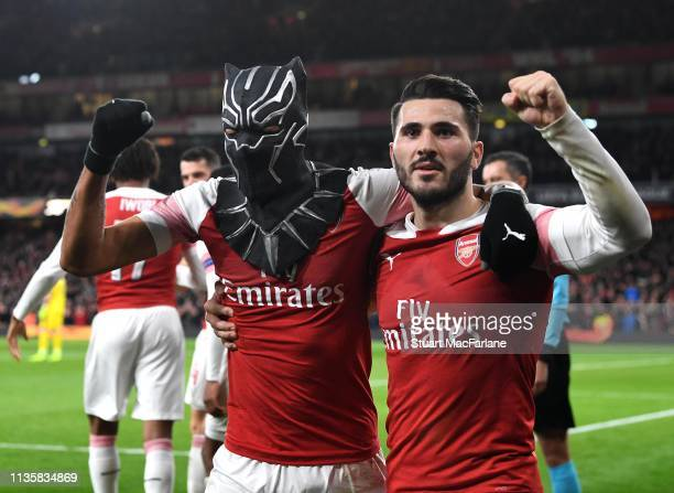 PierreEmerick Aubameyang celebrates scoring the 3rd Arsenal goal with Sead Kolasinac during the UEFA Europa League Round of 16 Second Leg match...