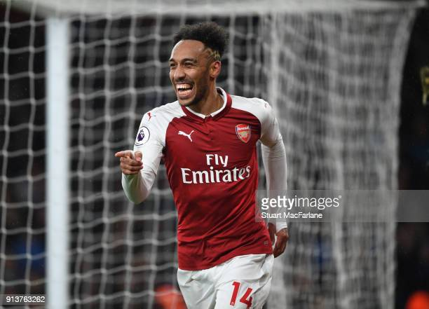 PierreEmerick Aubameyang celebrates scoring the 4th Arsenal goal during the Premier League match between Arsenal and Everton at Emirates Stadium on...