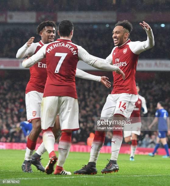 PierreEmerick Aubameyang celebrates scoring the 4th Arsenal goal with Alex Iwobi and Henrikh Mkhitaryan during the Premier League match between...