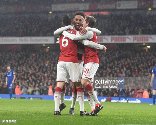 PierreEmerick Aubameyang celebrates scoring the 4th Arsenal goal with Laurent Koscielny and Nacho Monreal during the Premier League match between...