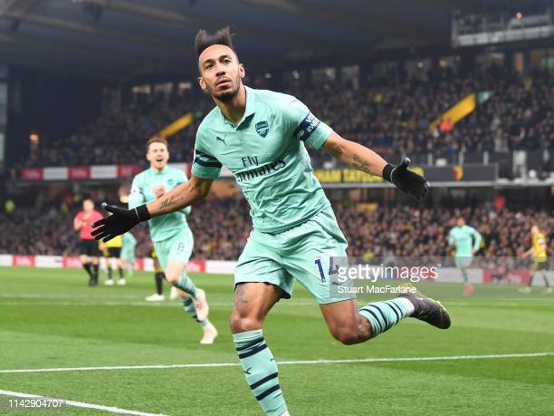 PierreEmerick Aubameyang celebrates scoring the Arsenal goal during the Premier League match between Watford FC and Arsenal FC at Vicarage Road on...