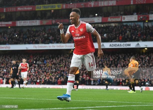 PierreEmerick Aubameyang celebrates scoring the Arsenal goal during the Premier League match between Arsenal FC and Wolverhampton Wanderers at...