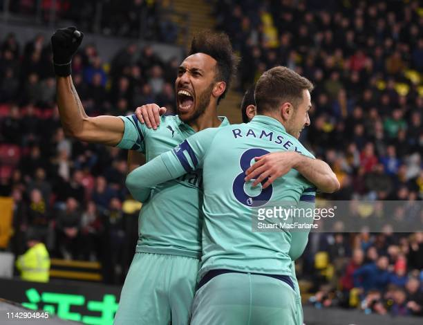 PierreEmerick Aubameyang celebrates scoring the Arsenal goal with Aaron Ramsey during the Premier League match between Watford FC and Arsenal FC at...