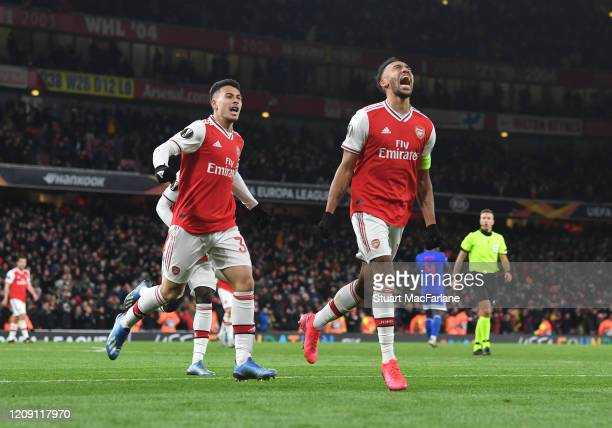 PierreEmerick Aubameyang celebrates scoring the Arsenal goal with Gabriel Martinelli during the UEFA Europa League round of 32 second leg match...