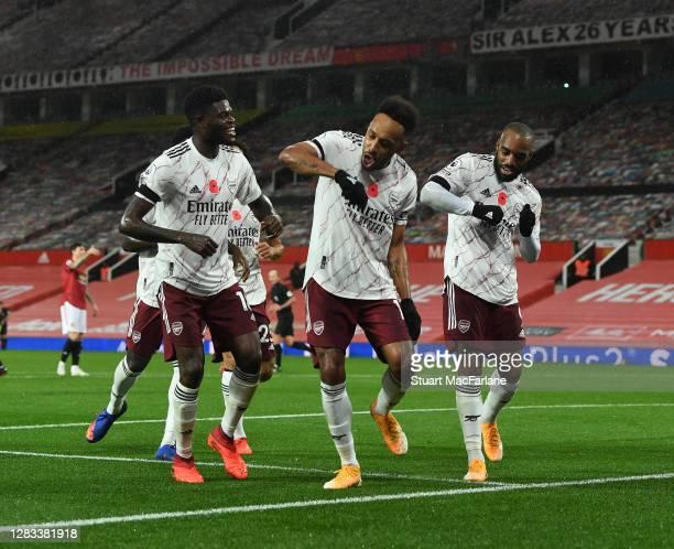 Pierre-Emerick Aubameyang celebrates scoring the Arsenal goal with Thomas Partey and Alex Lacazette during the Premier League match between...