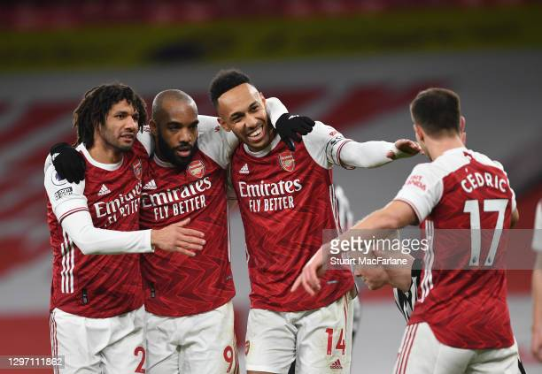 Pierre-Emerick Aubameyang celebrates scoring the third Arsenal goal with Mo Elneny , Alex Lacazette , and Cedric during the Premier League match...